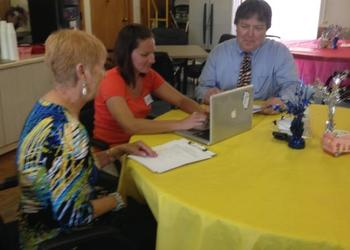 Carin Deitler, paralegal, and Robert Bernard, attorney, assist a client with the creation of advance directives documents.