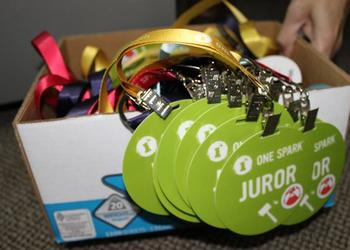 Jurors, creators and just about everyone associated with putting on One Spark will have similar badges. This boxful is in Murphy's office, although there are many others around the One Spark offices.