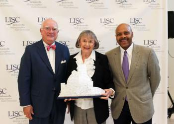 LISC Jacksonville board Chair J.F. Bryan, Delores Barr Weaver and LISC National President Maurice Jones.