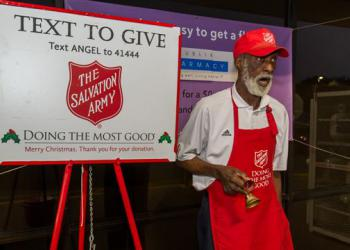 "Harold Pierce sings ""Yesterday"" while he rings the bells for The Salvation Army of Northeast Florida kettle campaign outside the Publix Super Markets store at Townsend and Merrill roads. After Thanksgiving, Pierce will be singing Christmas carols, inc..."