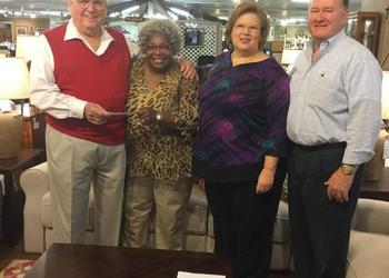 Orange Park Furniture donated $56,500 to Clay County Habitat for Humanity to build a new home for a partner family member. From left are Elmer (E.J.) James, owner of Orange Park Furniture; Carolyn Edwards, executive director of Clay County Habitat fo...