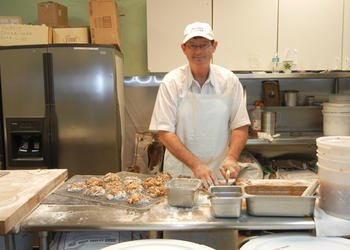 David Unkelbach was making apple fritters this morning at The Donut Shoppe in Arlington. He plans to move the business down the street this spring.