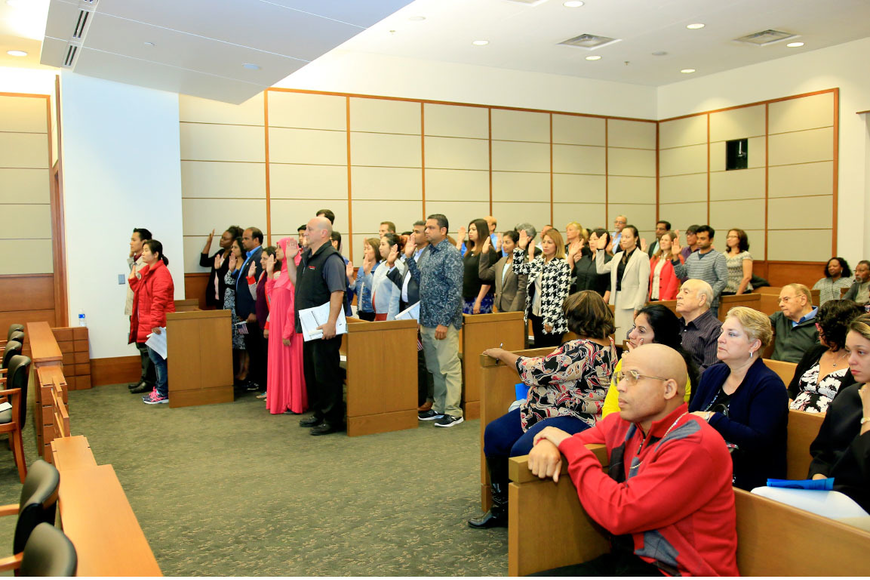 People from 22 countries took the U.S. Oath of Allegiance administered by U.S. District Judge Timothy Corrigan on Oct. 26 at the Bryan Simpson U.S. Courthouse. Photos by Edward Fernandez, Executive Video & Photographic Services