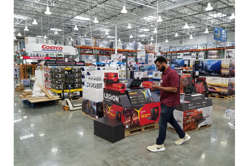 The new Costco features an area promoting items sold online.