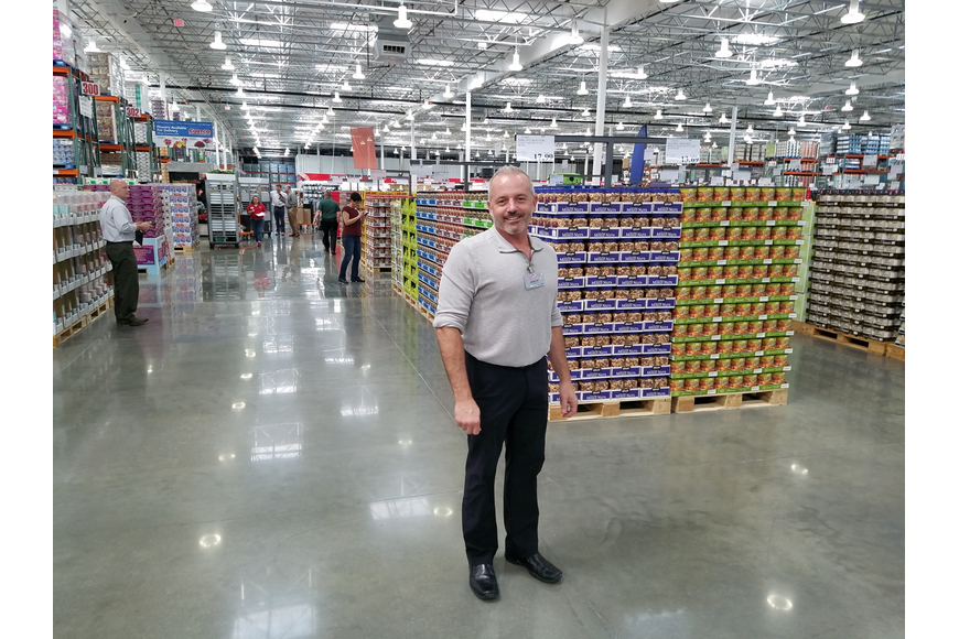 Jason Zook, warehouse manager of the new store, held the same position at the Town Center Costco.