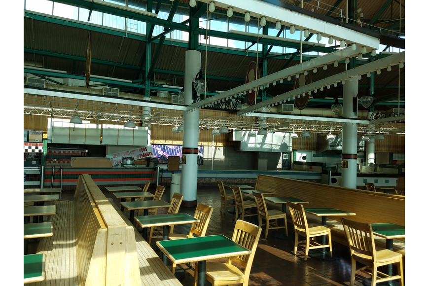 Tables and chairs remain inside the food court.
