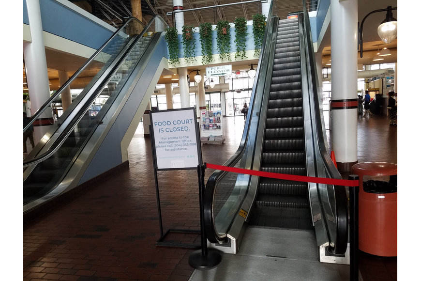 The escalator to the second floor food court at the Jacksonville Landing is blocked off.