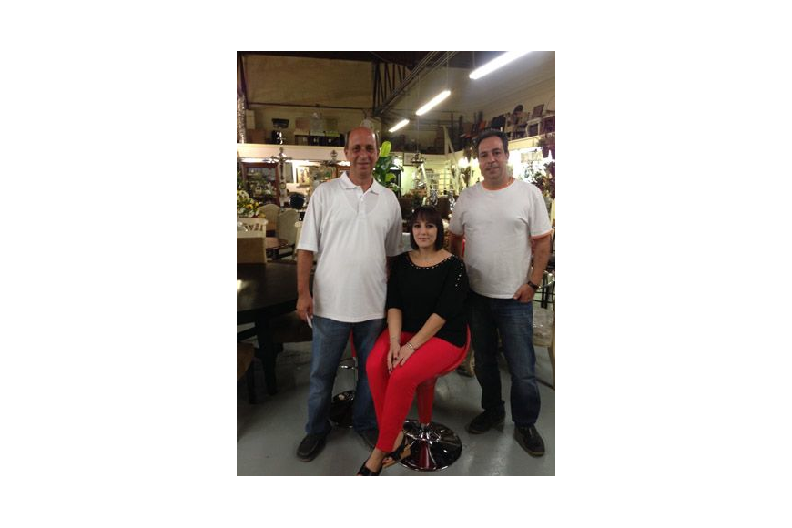 From left, Sam Kassab, his wife, Rola Kassab, and his brother, Tony Kassab, want to resume furniture imports at Mary's Wholesale Furniture.
