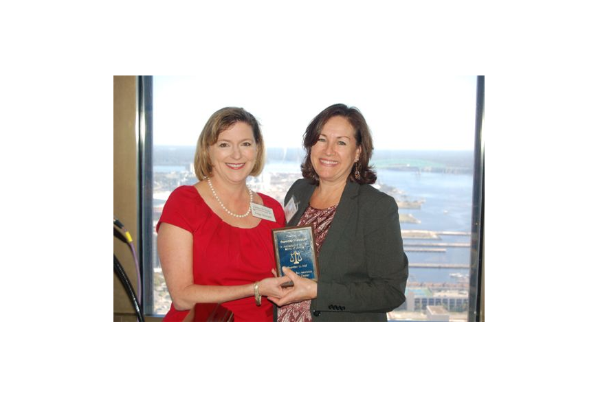 U.S. District Judge Marcia Morales Howard, left, and Susanne Weisman, law clerk for U.S. District Judge Timothy Corrigan. Weisman received a Federal Bar Association Jacksonville Chapter 2015 Spirit of Giving Award.