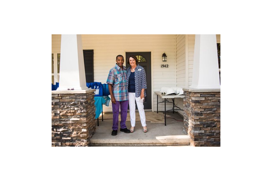 Mary Kay O'Rourke, executive director of HabiJax, congratulated Andre'a Raysor for his family becoming the 2,000th to be served by the local affiliate of Habitat for Humanity International.