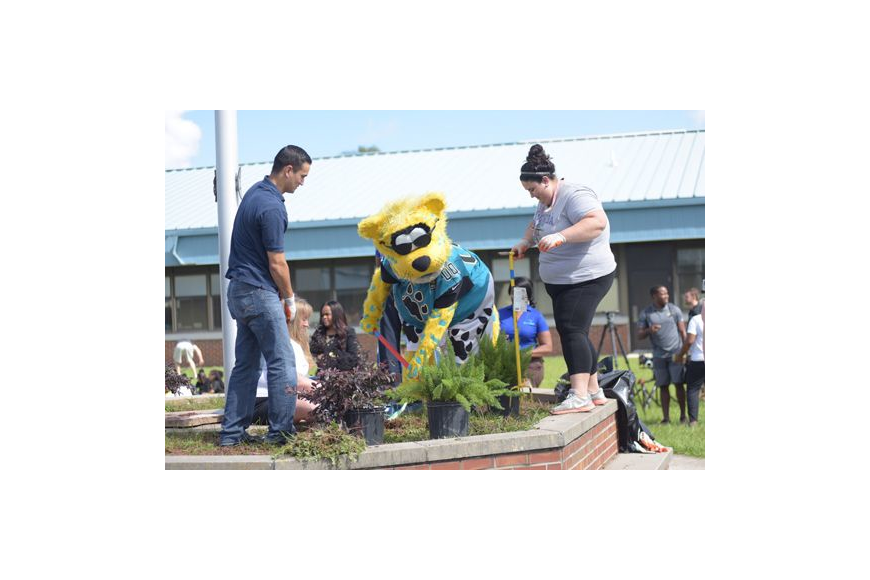 United Way of Northeast Florida volunteers and Jacksonville Jaguars mascot Jaxson de Ville helped beautify S.P. Livingston Elementary School in New Town as part of the annual Hometown Huddle service event.