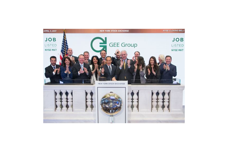 Officials of the GEE Group ring the bell to close the New York Stock Exchange on April 3.