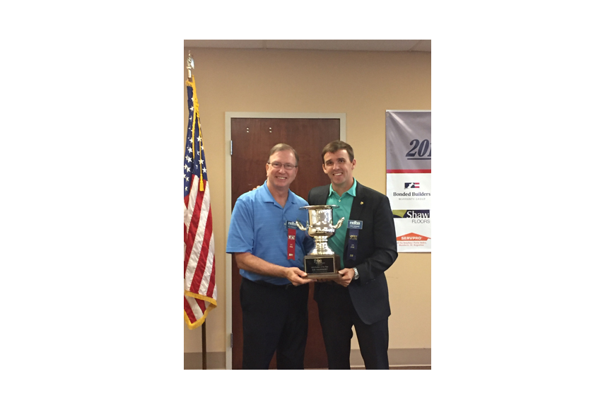 Lee Arsenault, left, was installed as president of the Northeast Florida Builders Association for 2017. At right is Chet Skinner, outgoing president for 2016, who recently presented Arsenault the Florida Home Builders Association's Builder of the Year...