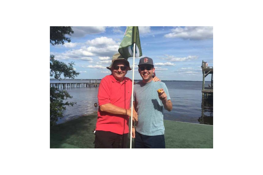 Attorney Steve Pajcic, left, with Thomas Lloyd, who sank a hole-in-one last year to win $6,000 and a matching donation for Jacksonville Area Legal Aid from The Law Firm of Pajcic & Pajcic.